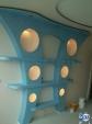 Стена с рафтове и ниши от гипсокартон